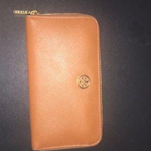 Tory Burch tan brown wallet.